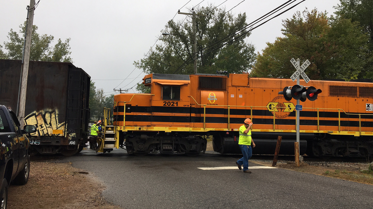 A woman was taken to the hospital after an accident involving a freight train and a car on West Street in Stafford Tuesday morning, according to emergency dispatchers.