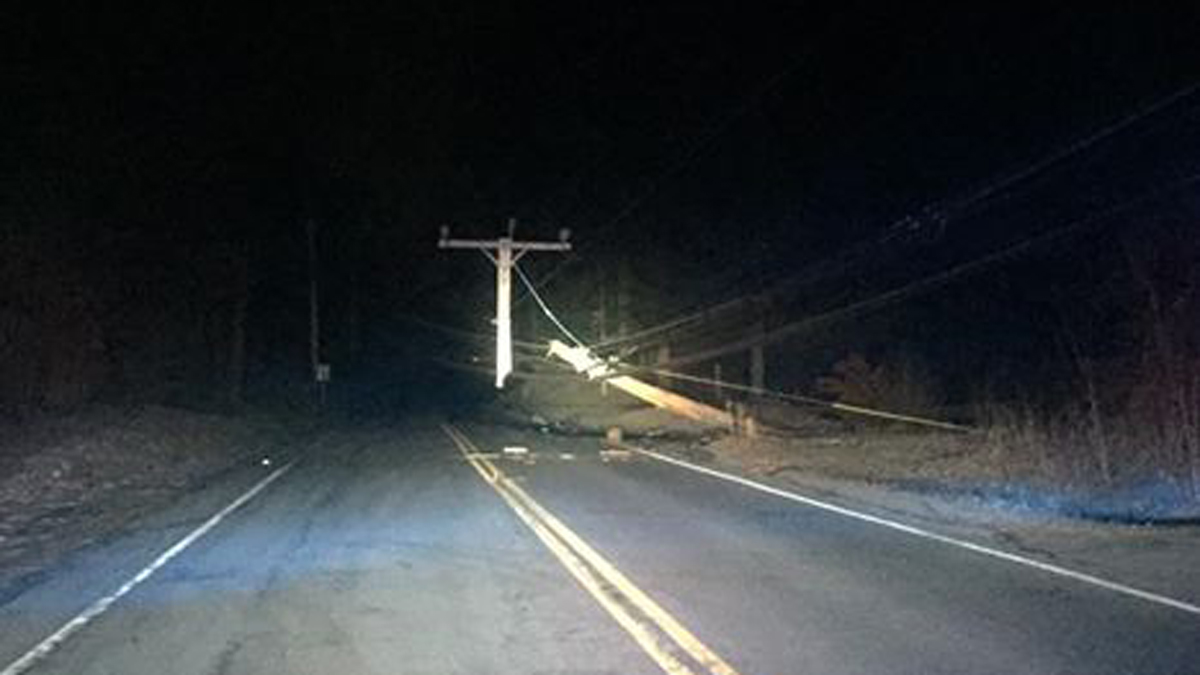 Mountain Road in Suffield was closed Monday morning after a car struck a pole, taking down wires.
