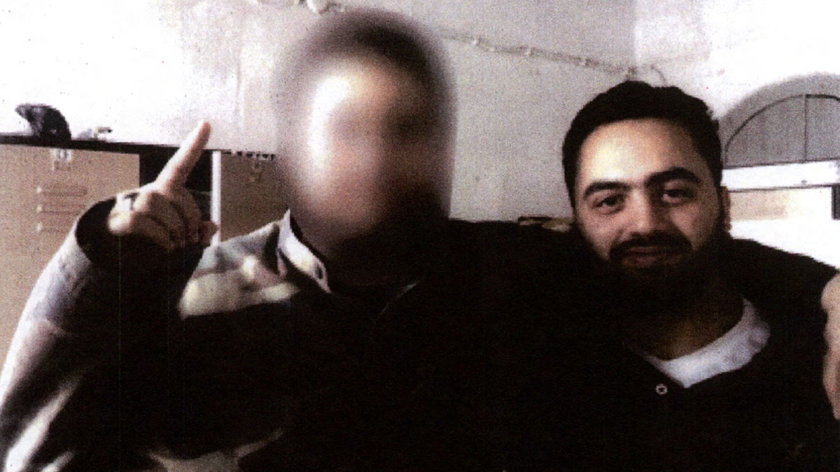 Another image in the complaint shows Saeed with a man identified by federal prosecutors as A.O.G. Officials say he is a known member of ISIL.