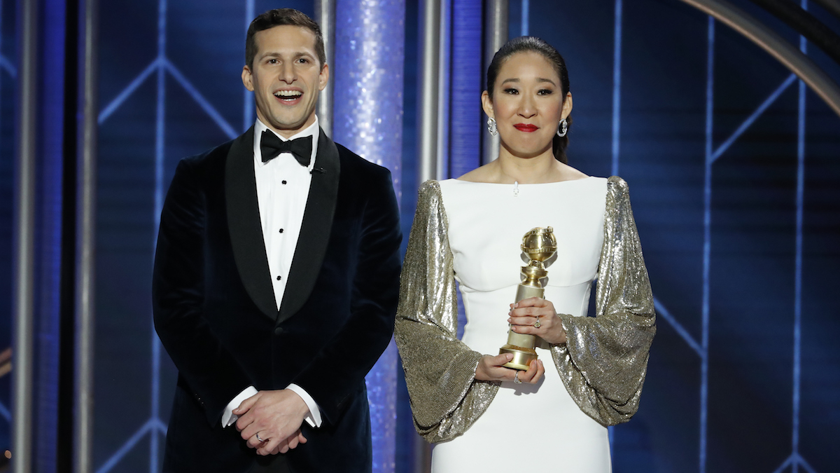 In this handout photo provided by NBCUniversal, Hosts Andy Samberg and Sandra Oh speak onstage during the 76th Annual Golden Globe Awards at The Beverly Hilton Hotel on January 06, 2019 in Beverly Hills, California.