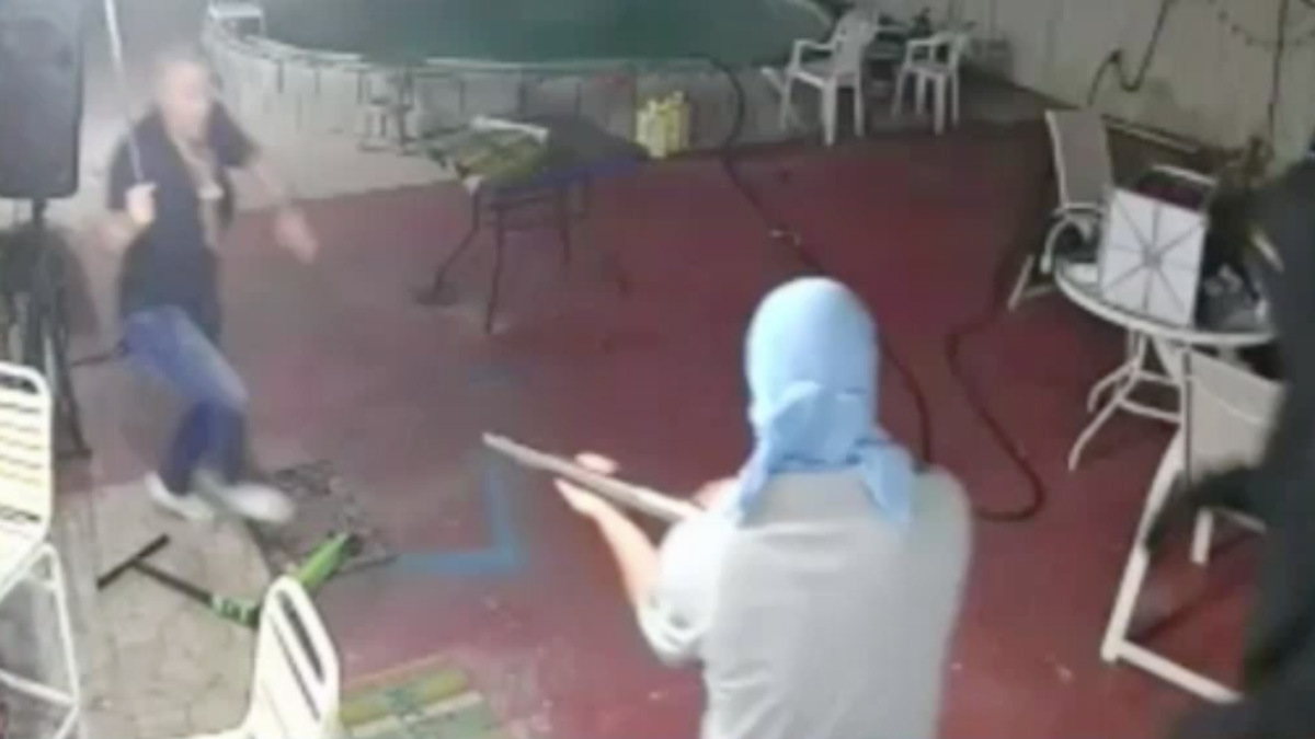 Surveillance video showing the moment when a homeowner fought off five would-be robbers with a machete.