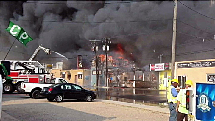 Businesses in Seaside Park, N.J., burn Thursday evening in a massive fire that engulfed part of the town.