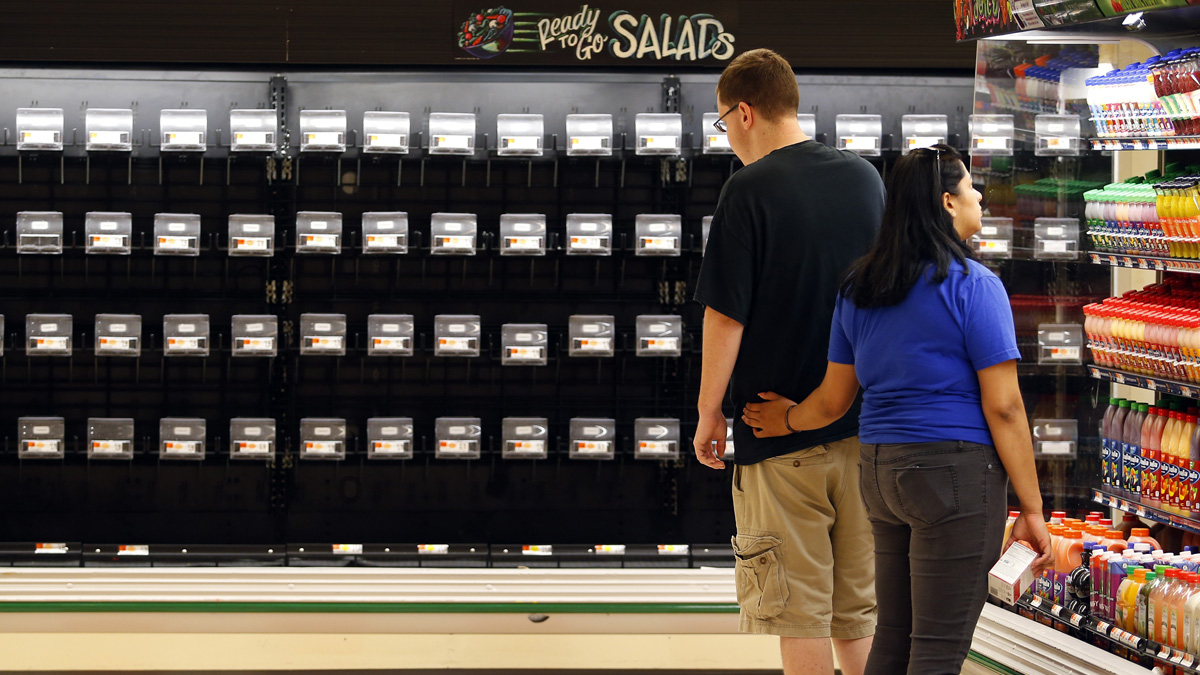 Customers look at limited options inside the produce section at the Market Basket in Tewksbury, Massachusetts on July 21, 2014.
