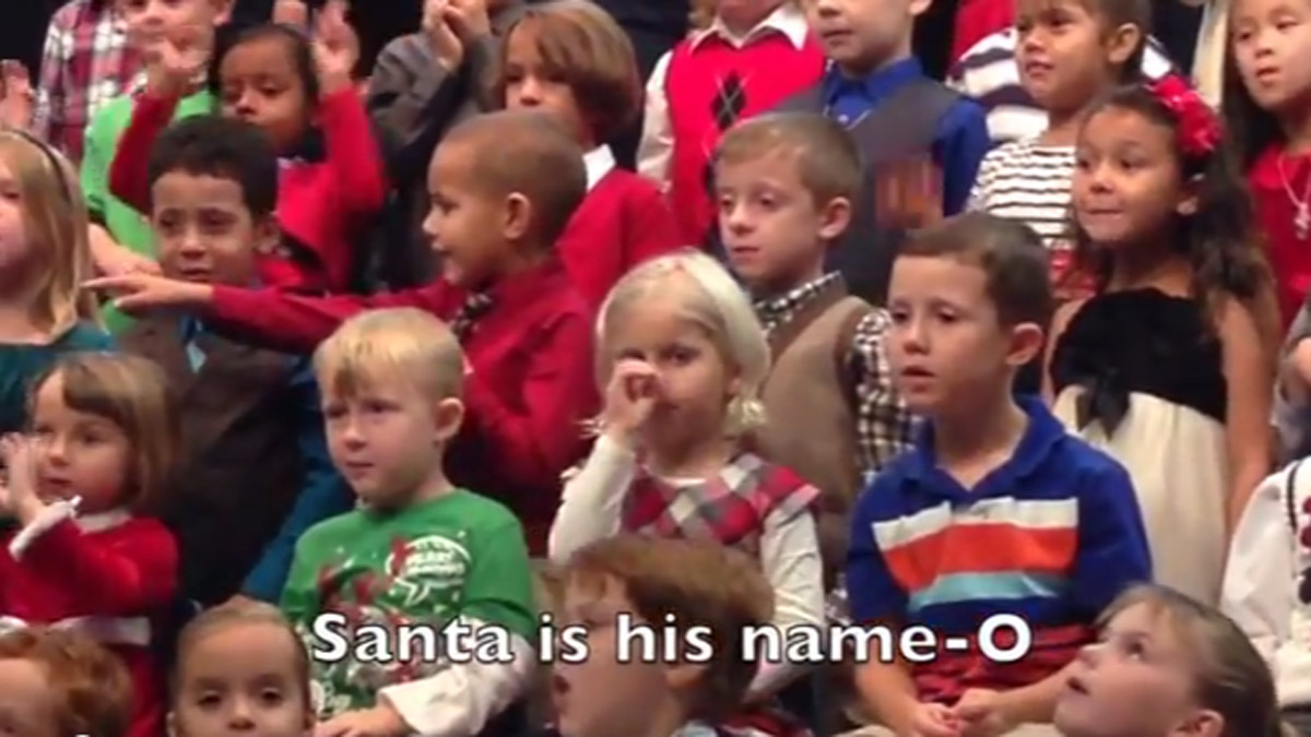 Claire Koch (center) uses sign language to sing a Christmas song so her deaf parents can understand the lyrics.