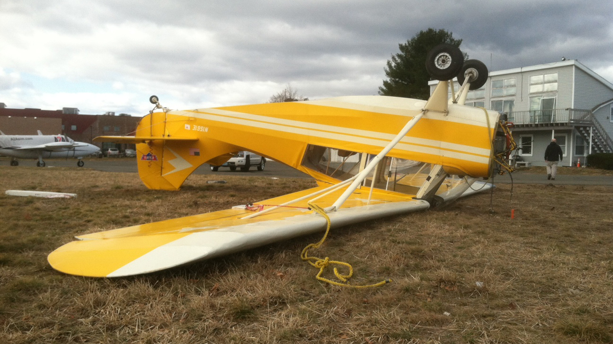 High winds caused a small plane at the Simsbury Airport to flip over Thursday morning. Officials said the plane was tied down but the wind pulled the anchors loose.