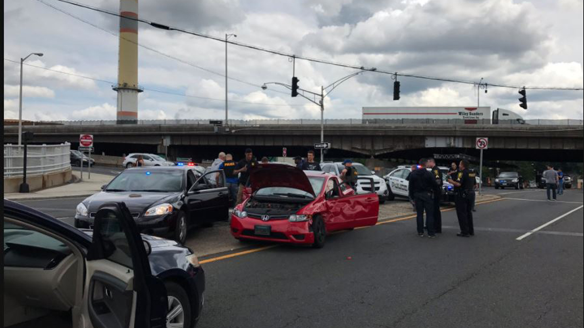 Sigourney Street in Hartford was closed near the I-84 exit ramps after a shooting suspect led police on a chase that ended in a crash, police said Tuesday afternoon.