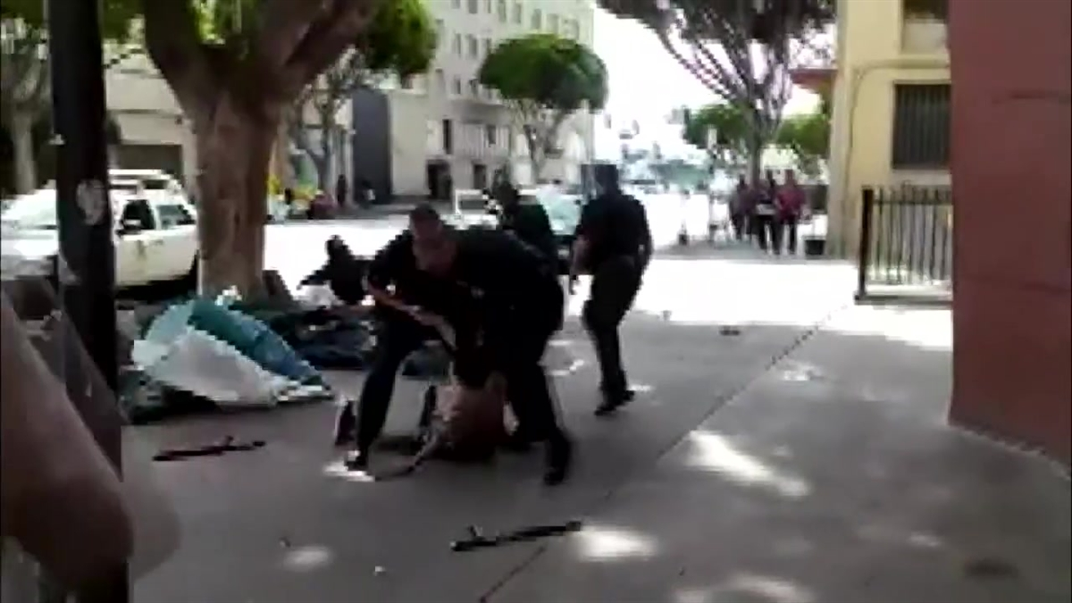 Cellphone video shows the moments when a homeless man was fatally shot by LAPD officers on Skid Row March 1, 2015.