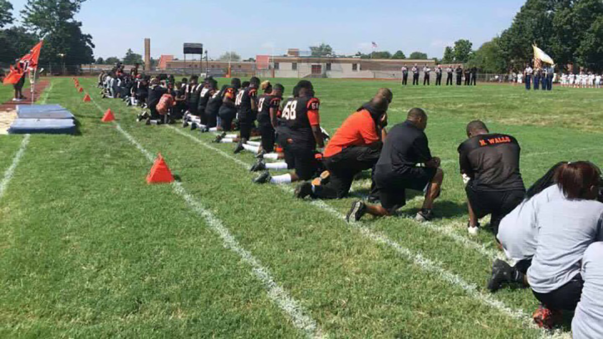 Players and coaches from Woodrow Wilson High School in Camden carried out the silent demonstration as