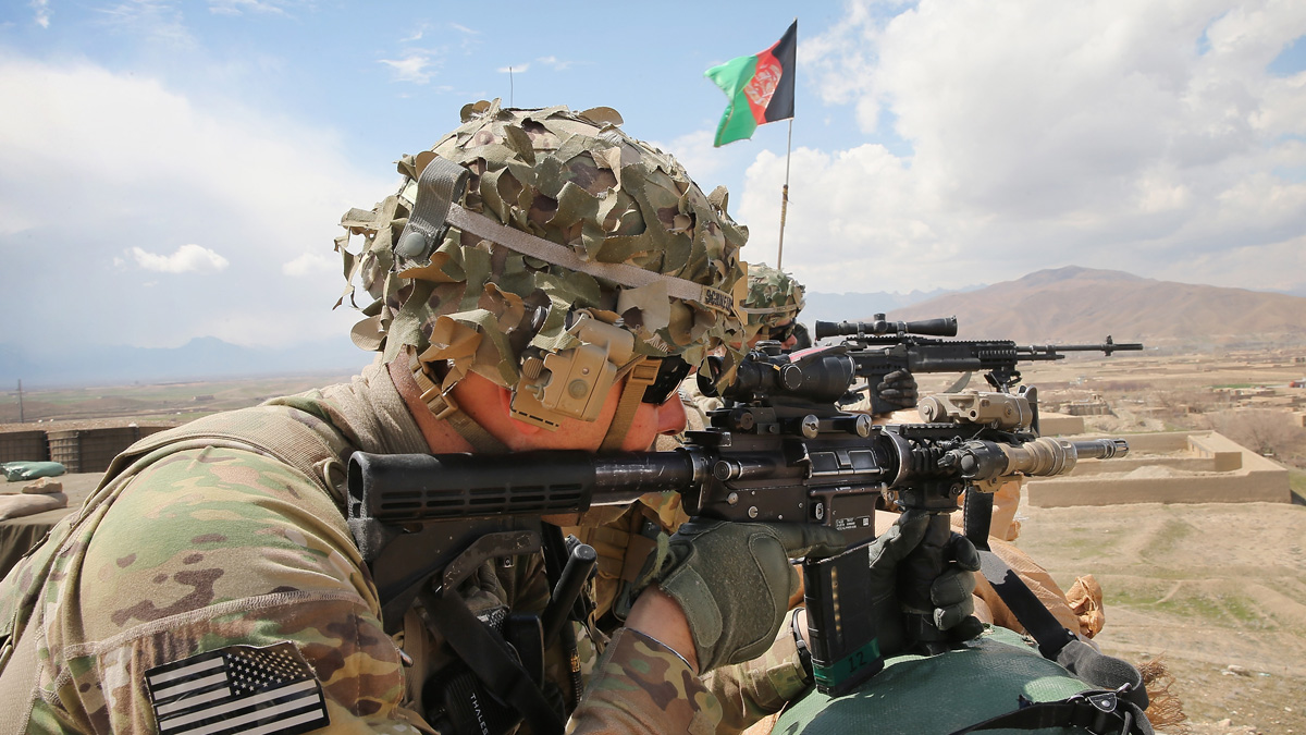 In this file photo, U.S. Army Soldier, SGT Kurtis Scheinder keeps watch from inside an Afghan National Army outpost on March 29, 2014 near Pul-e Alam, Afghanistan.