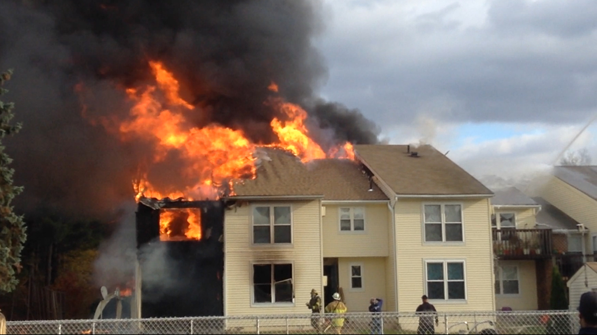 Flames showing from the roof of one of the buildings at the condo complex on Pleasant Valley Road in South Windsor.