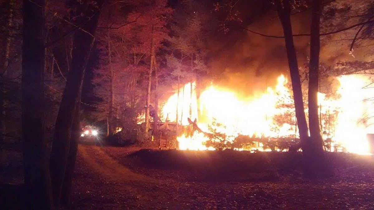 A brush fire ripped through a Stafford campground Sunday night, destroying four campers.