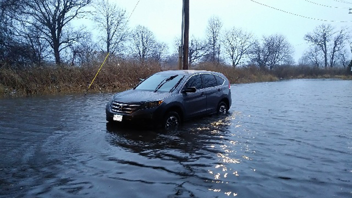 A woman had to be rescued when floodwaters rose on Surf Avenue in Stratford Tuesday morning.