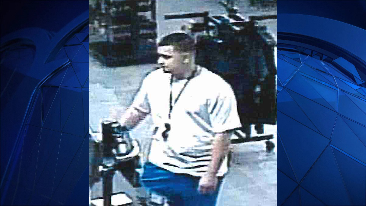 Surveillance footage captured images of a suspect police say broke into a gym locker and stole two debit cards in October.