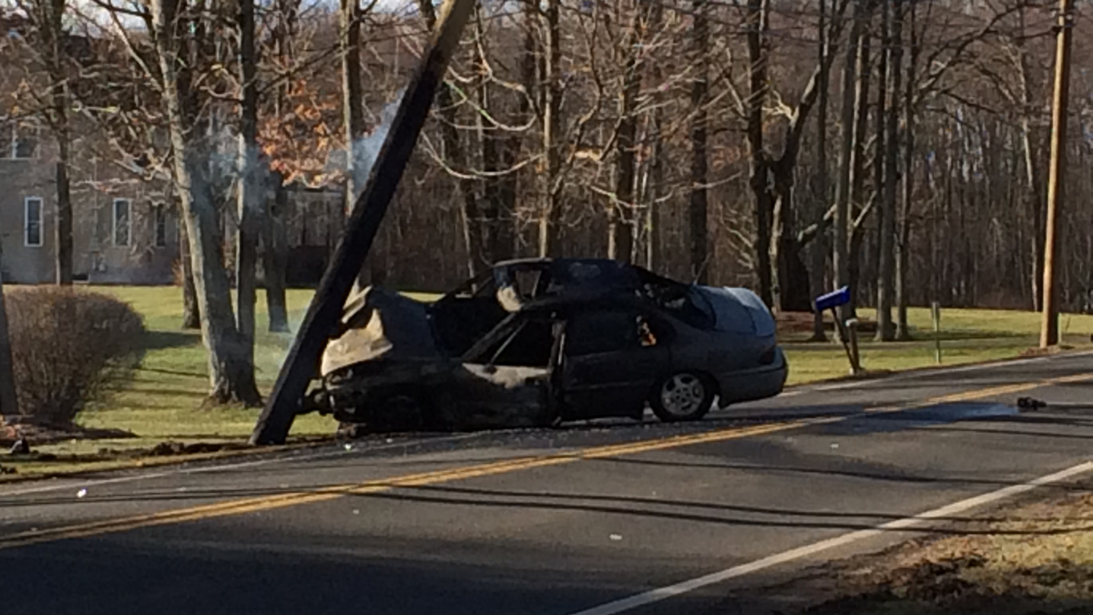 One person was taken to the hospital after a car struck a pole and caught fire in Suffield Thursday morning.