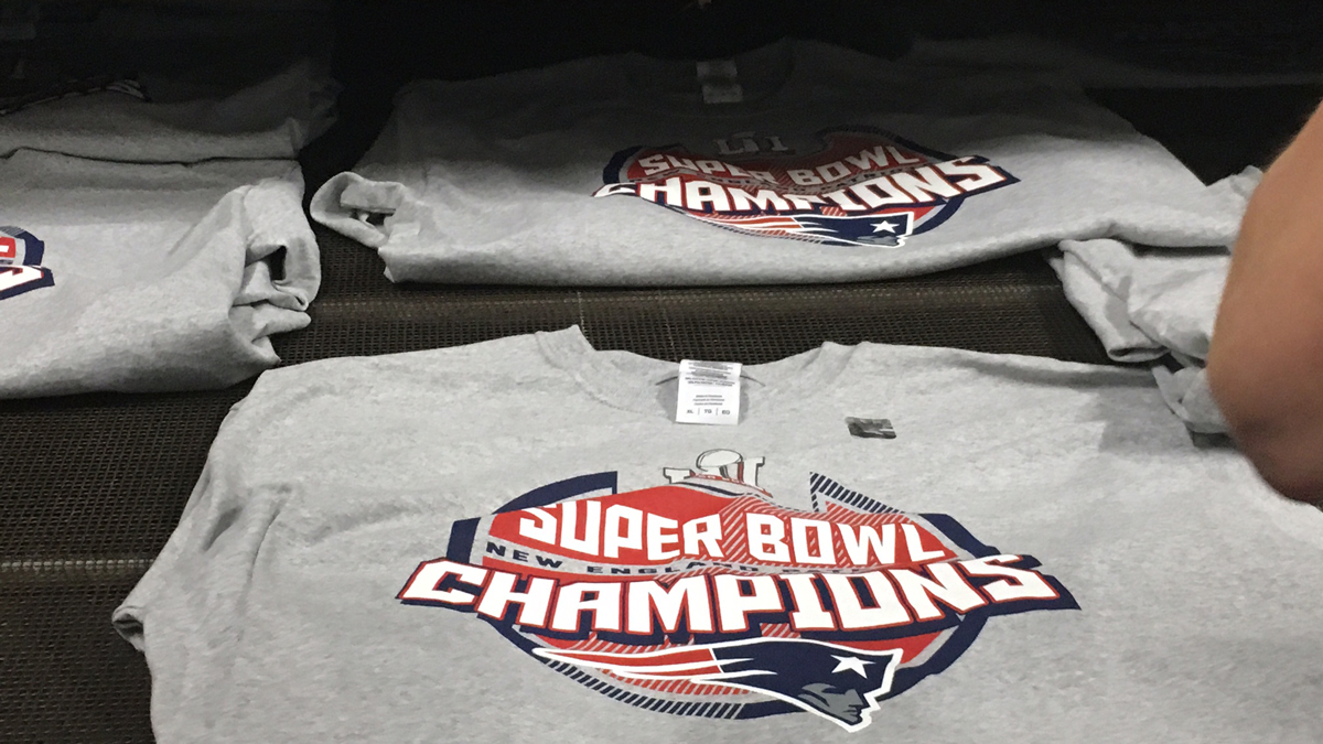 The team at Zuse Inc. in Guilford set to work overnight, churning out t-shirts celebrating the Patriots stunning Super Bowl win.