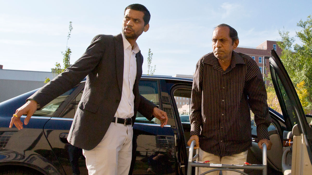 In this Tuesday, Sept. 1, 2015, file photo, Chirag Patel helps his father, Sureshbhai Patel, out of the car as they arrive outside the federal courthouse before start of a trial against Madison, Ala., police Officer Eric Sloan Parker, in Huntsville, Ala. The assault charges against Parker were dropped.