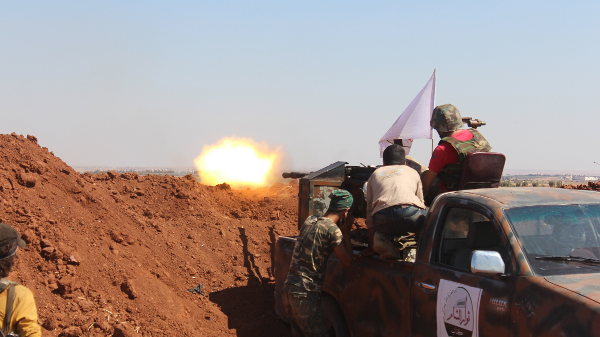 Members of Syrian opposition group linked to Damascus Front (Shamiyya Front) launch attacks against Daesh terrorists in Tilalyan village, north of Aleppo, Syria on August 28, 2015.