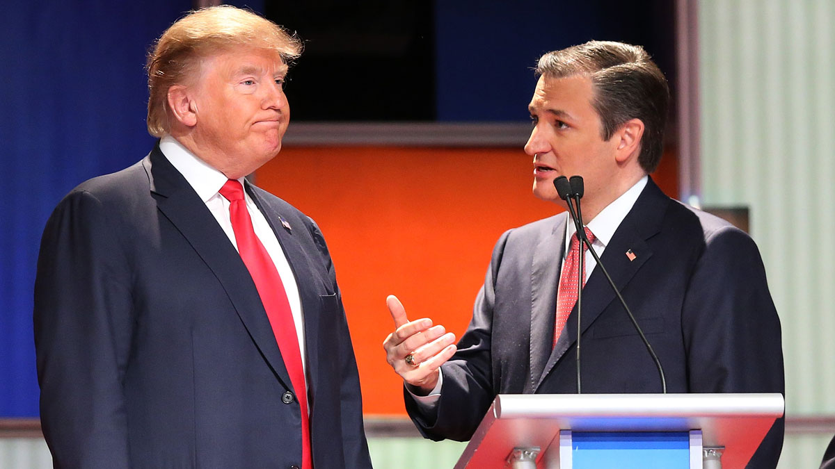Donald Trump and Ted Cruz speak during a commercial break in the Fox Business Network Republican presidential debate in North Charleston, SC, Jan. 14.