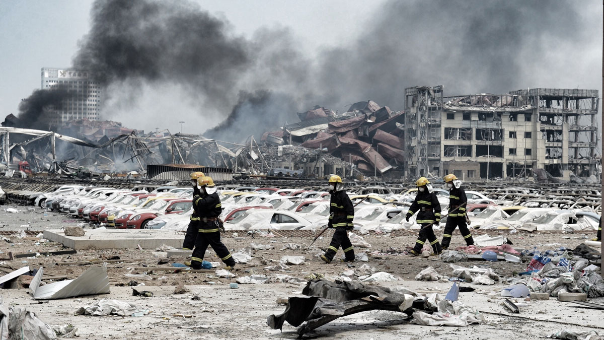 Fire workers work at accident site after massive explosion on August 14, 2015 in Tianjin, China. Over 700 injured and evacuated people stay at the emergency shelter set at a primary school in Binhai New Area after Wednesday explosion of a warehouse in Tianjin. (Photo by ChinaFotoPress/ChinaFotoPress via Getty Images)