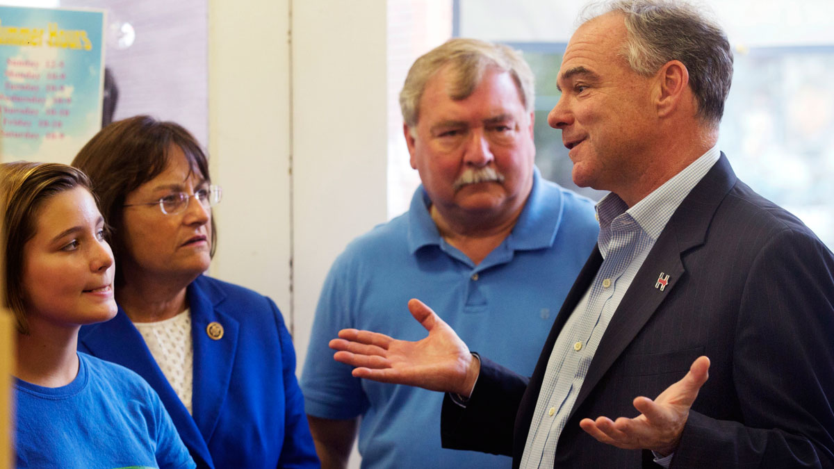 Democratic vice presidential candidate Sen. Tim Kaine, D-Va., right, talks with Charlotte Goble during a quick stop at Granite State Candy with Rep. Ann Kuster, D-N.H., and state Rep. Steve Shurtleff in Concord, N.H. Friday, Aug. 12, 2016.