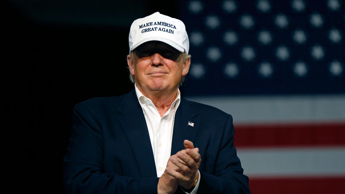 Republican presidential candidate Donald Trump arrives onstage to speak at a rally in Dimondale, Mich.. on Aug. 19, 2016.