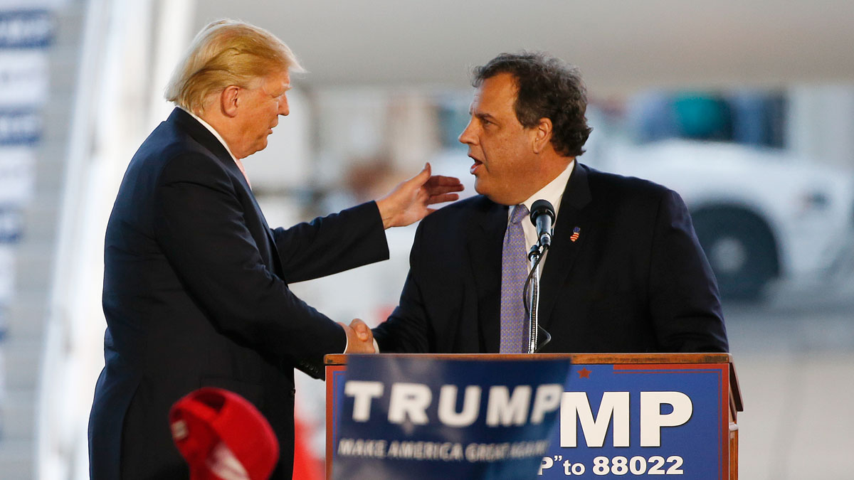 Republican presidential candidate, Donald Trump, left, is introduced by New Jersey Gov. Chris Christie at a plane-side rally in an aircraft hanger at Youngstown-Warren Regional Airport in Vienna, Ohio, on Monday, March 14, 2016.
