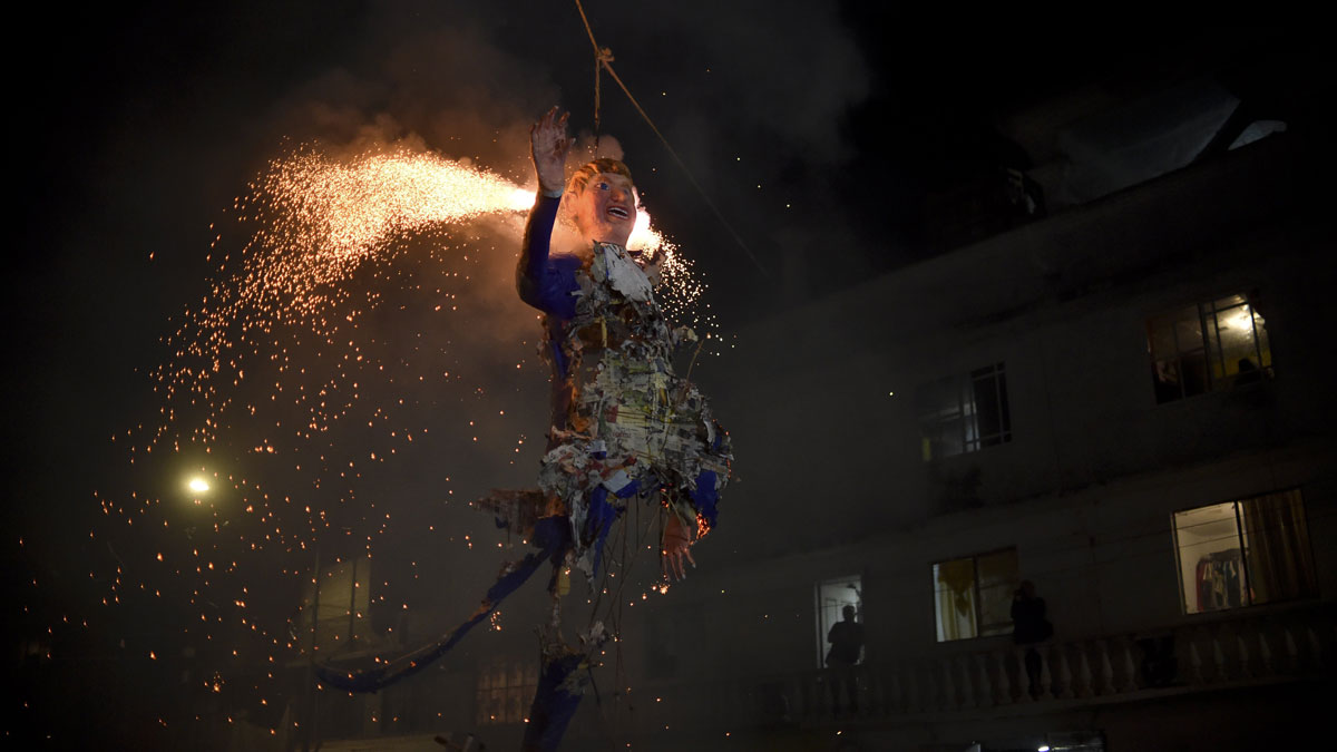 Mexicans set fire to an effigy of US Republican presidential candidate Donald Trump on March 26, 2016 in Mexico City during Holy Week celebrations. For many years Mexicans have made cardboard figures representing all forms of evil, which are then torched commemorating the