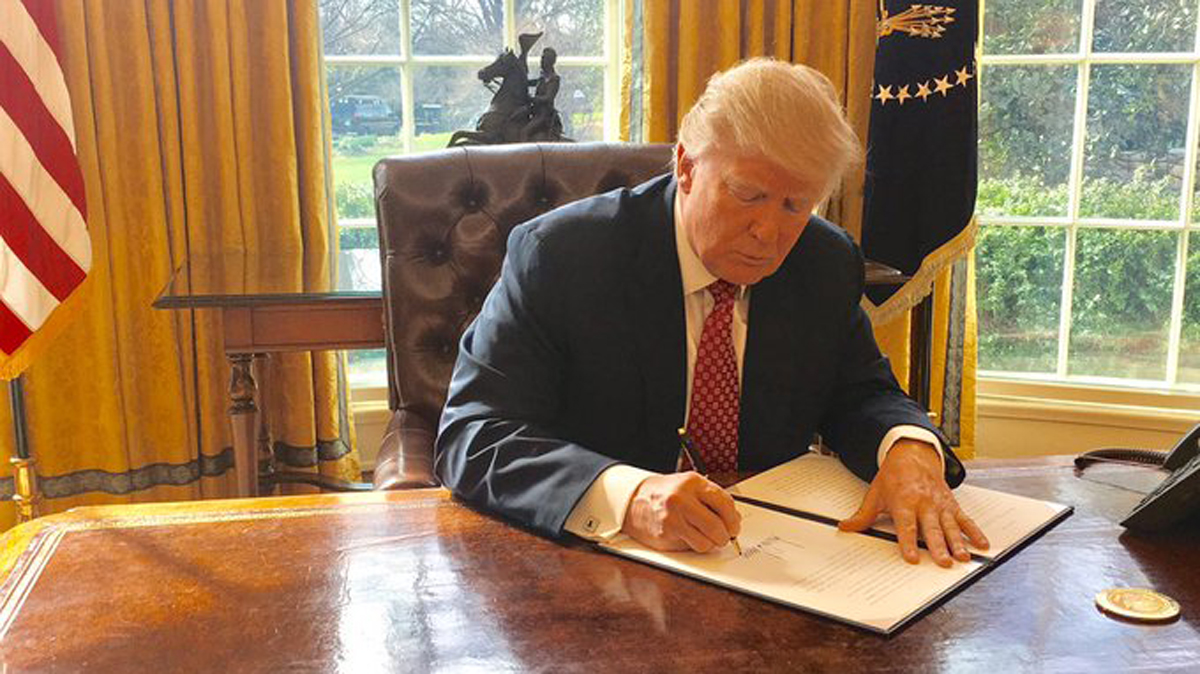 White House press secretary Sean Spicer released this image of President Donald Trump signing an executive order.