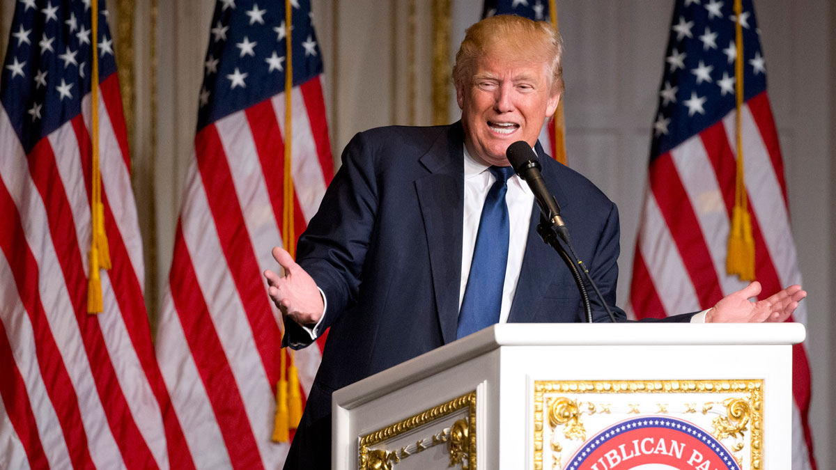 Republican presidential candidate Donald Trump speaks during the Palm Beach County GOP Lincoln Day Dinner at the Mar-A-Lago Club, Sunday, March 20. Two campaign sources told NBC News that Trump will aggressively raise funds for the general election, and the campaign expects voters understand he has to do