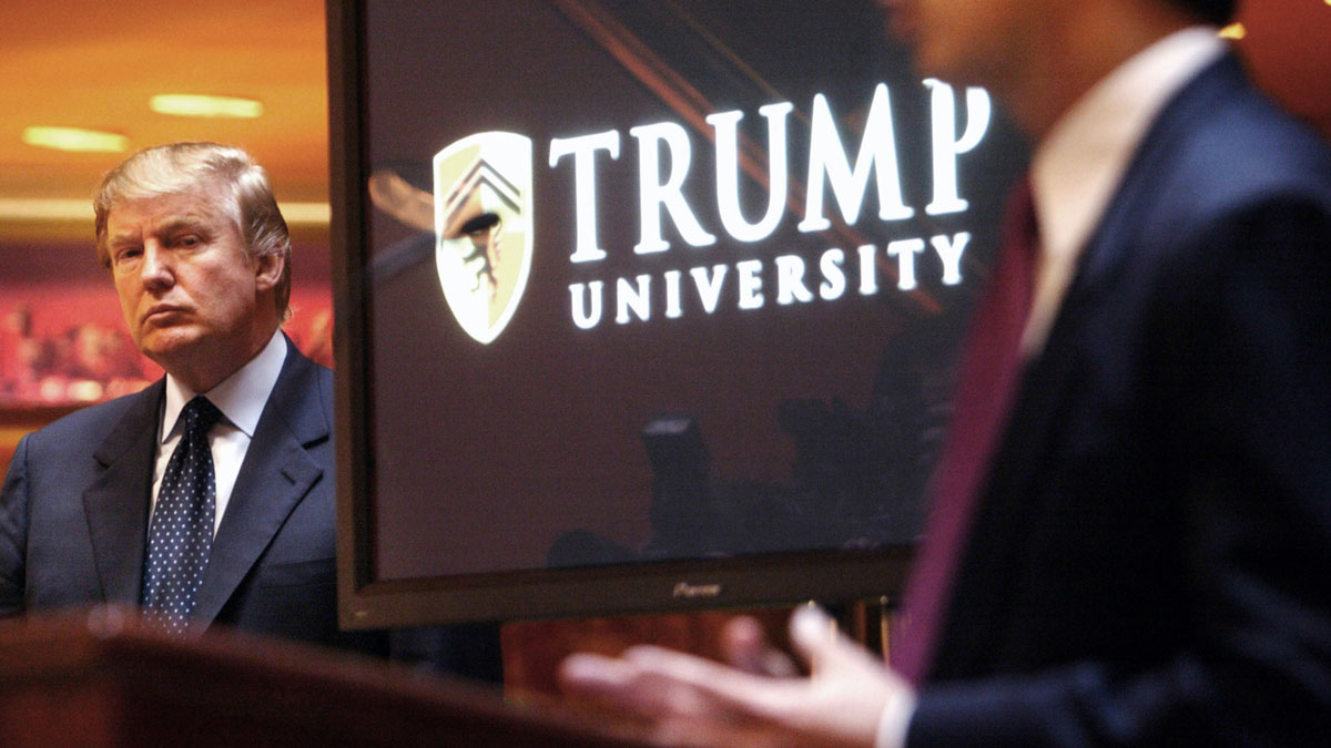 In this May 23, 2005, file photo, real estate mogul and Reality TV star Donald Trump, left, listens as Michael Sexton introduces him at a news conference in New York where he announced the establishment of Trump University.