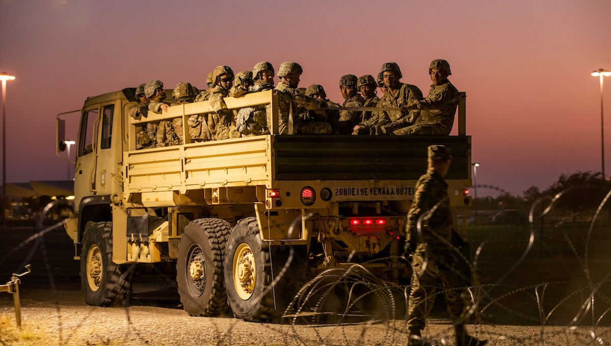 US Army troops enter a compound where the military is erecting an encampment near the US-Mexico border crossing at Donna, Texas, on November 6, 2018.
