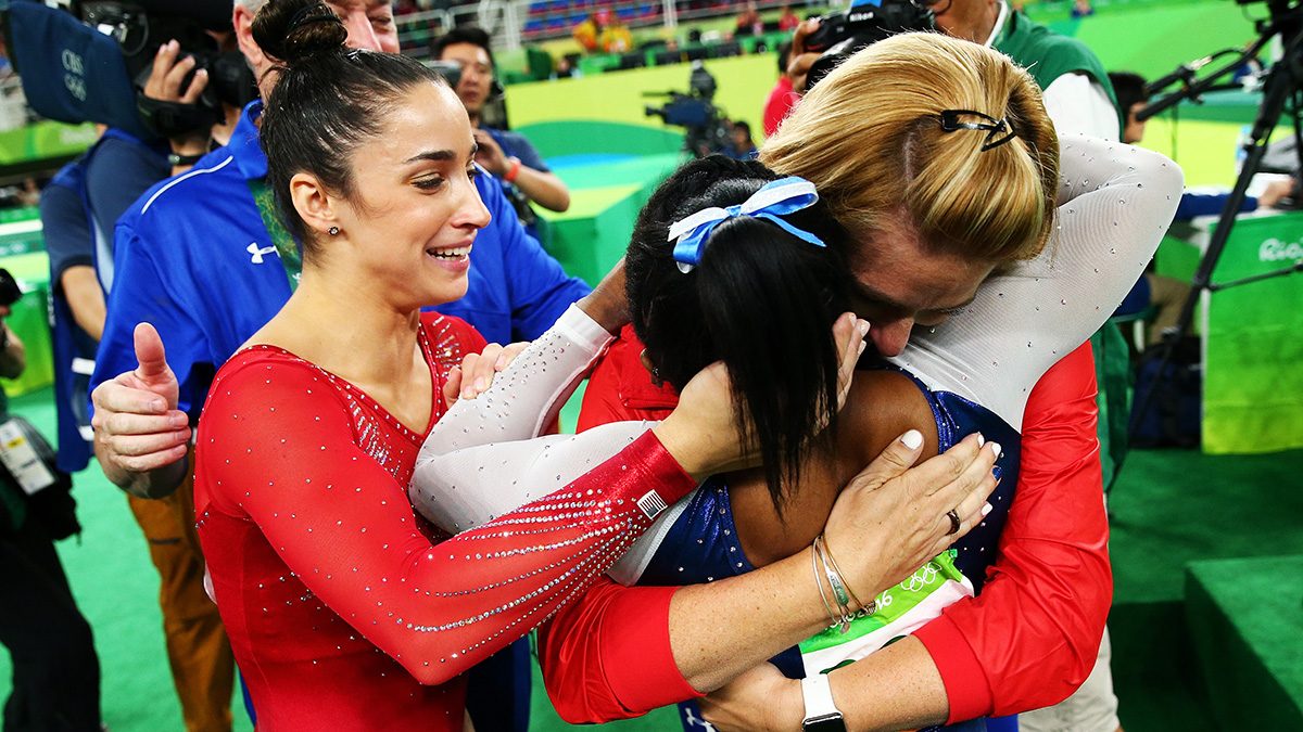 Simone Biles of the United States is embraced after competing on the floor during the Women's Individual All Around Final on Day 6 of the 2016 Rio Olympics at Rio Olympic Arena on Aug. 11, 2016 in Rio de Janeiro, Brazil.