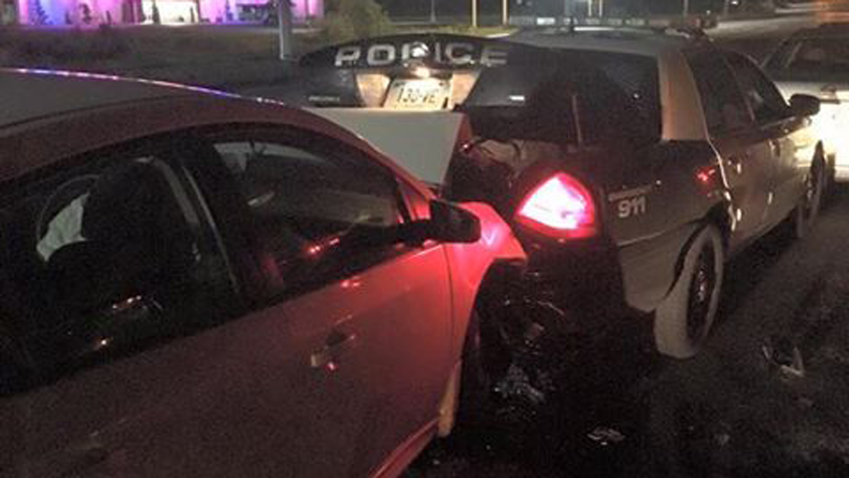 Vernon police say a driver that crashed into a Vernon police cruiser admitted to texting while driving.