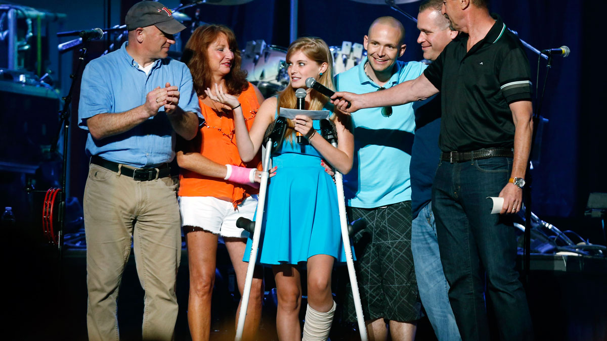 In this May 30, 2013 file photo, Boston Marathon bombing survivor Victoria McGrath, center, thanks people who helped her after she was injured in the bombing.