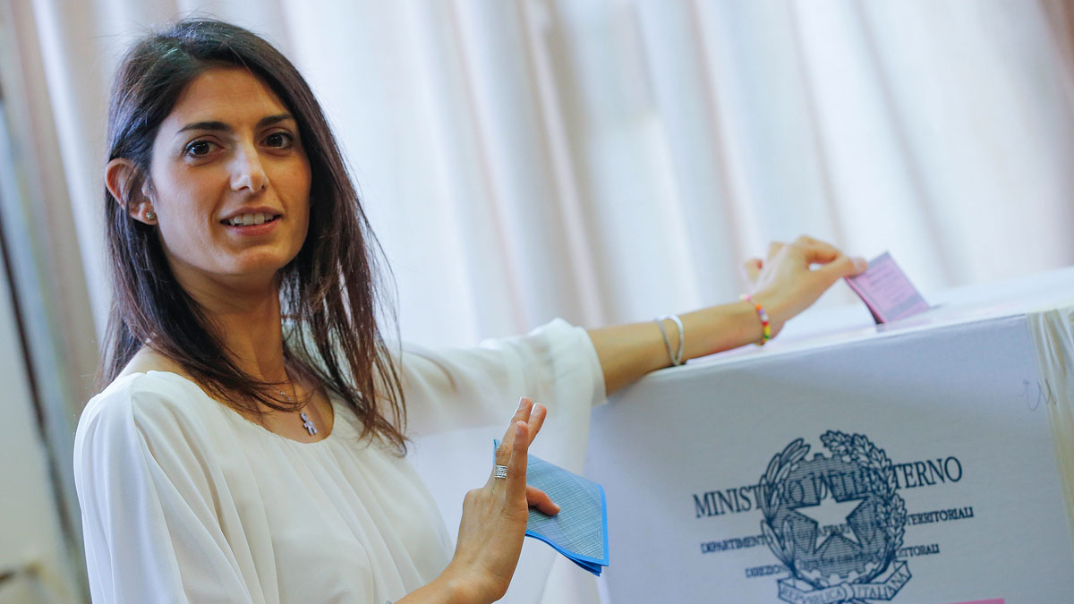 Anti-establishment 5-Star Movement (M5S) candidate as Rome's mayor Virginia Raggi poses for photographers as she casts her ballot in polling station in Rome, on June 19, 2016. Raggi won after her rival, Roberto Giachetti, conceded.