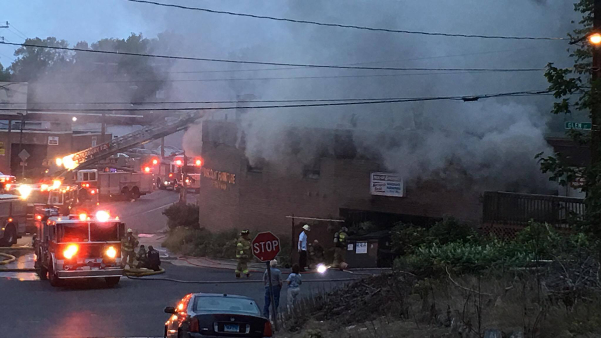 Fire broke out at a building on South Main Street near Piedmont Street in Waterbury Monday morning.