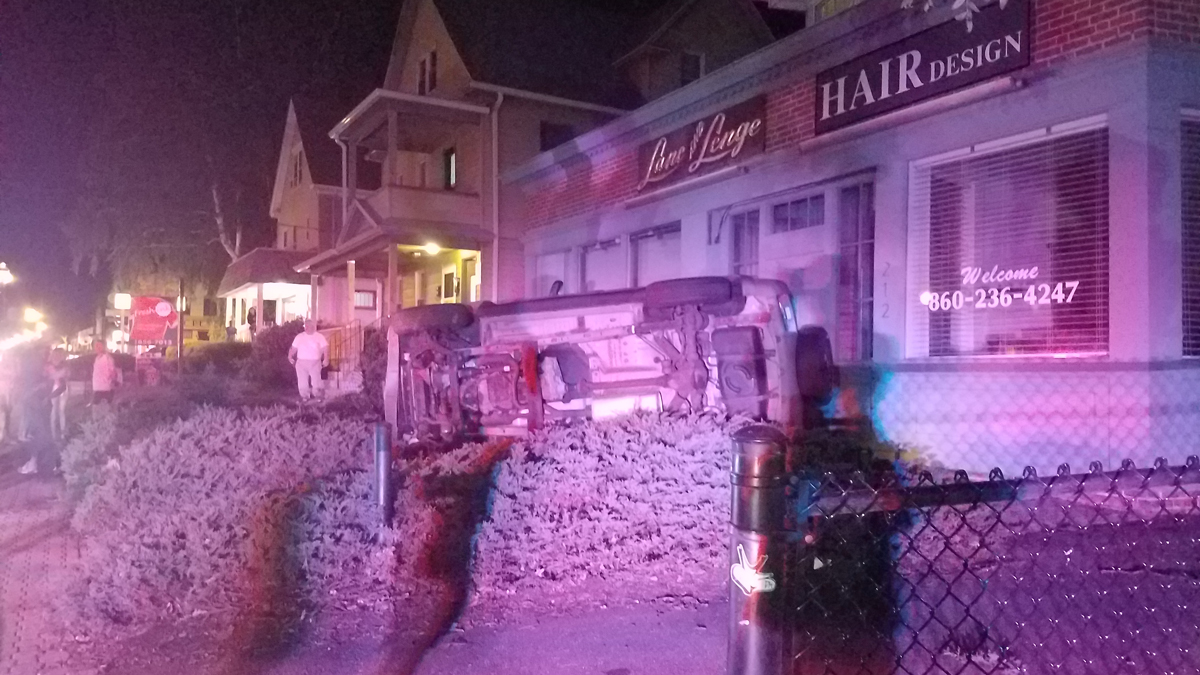Police say a driver fled the scene of a rollover crash on Park Road in West Hartford overnight.