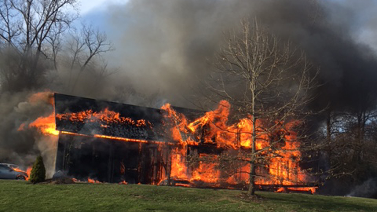 A home on Woodside Circle in Woodbury went up in flames Monday night.