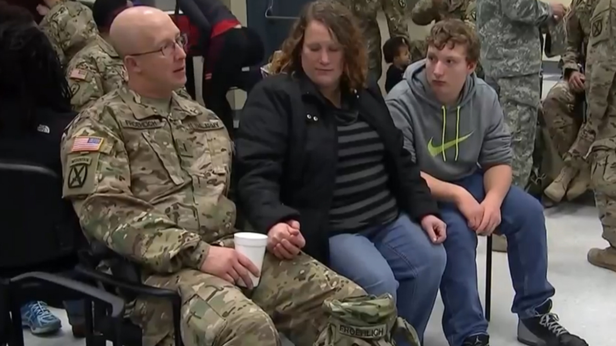 U.S. Army chief warrant officer Wade Froehlich (left) wasn't able to spend Christmas with his family again this year because he was on his third deployment to Afghanistan.