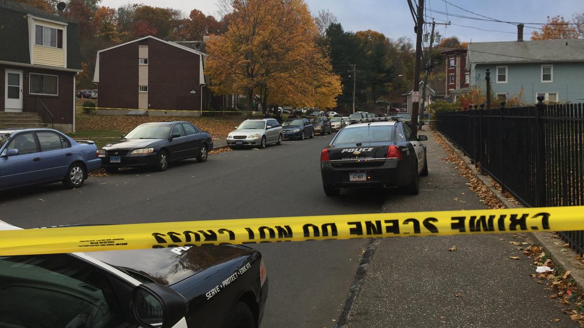 Crime scene tape blocked off a portion of Porter Street near Charles Street Saturday evening.