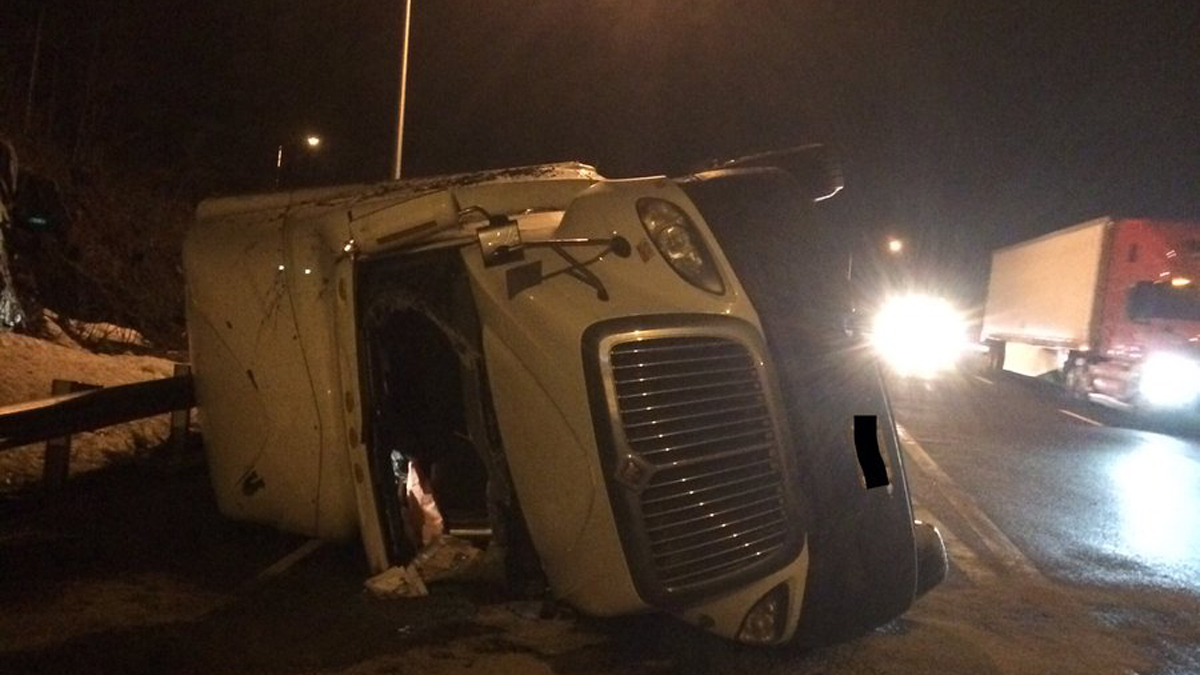 A tractor trailer carrying bananas caused delays on I-84 in Waterbury Wednesday when the truck flipped.