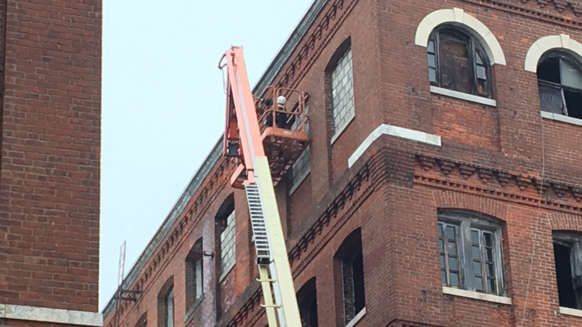 Waterbury is spending thousands of dollars to block about 60 windows of the former watch factory on Cherry Street to prevent the spread of potential fires.