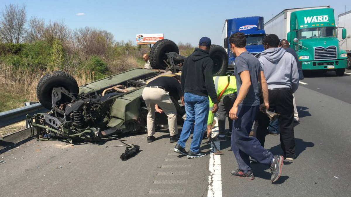A military vehicle overturned on the New Jersey Turnpike, hurting at least six people. (Photo courtesy Twitter user @WatseymWatsey)