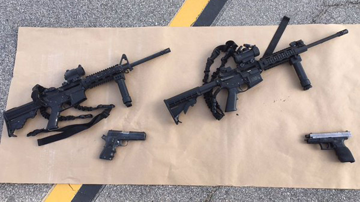 This photo provided by the San Bernardino County Sheriff's Department shows weapons carried by suspects at the scene of a shootout in San Bernardino, Calif.