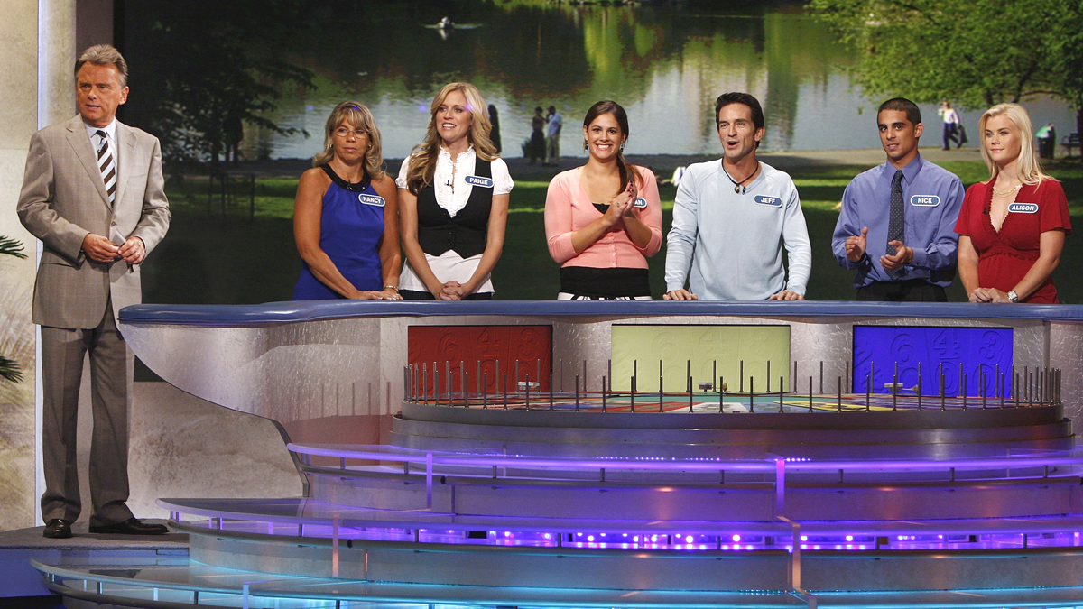 Host Pat Sajak, Nancy Kaufman, Paige Hemmis, Susan Moran, Jeff Probst, Nick Giovine, and Alison Sweeney at the taping of the