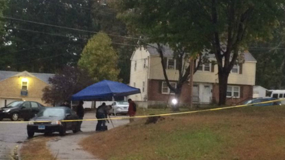 Detectives photographing evidence in a neighborhood on Emerald Avenue Sunday morning.