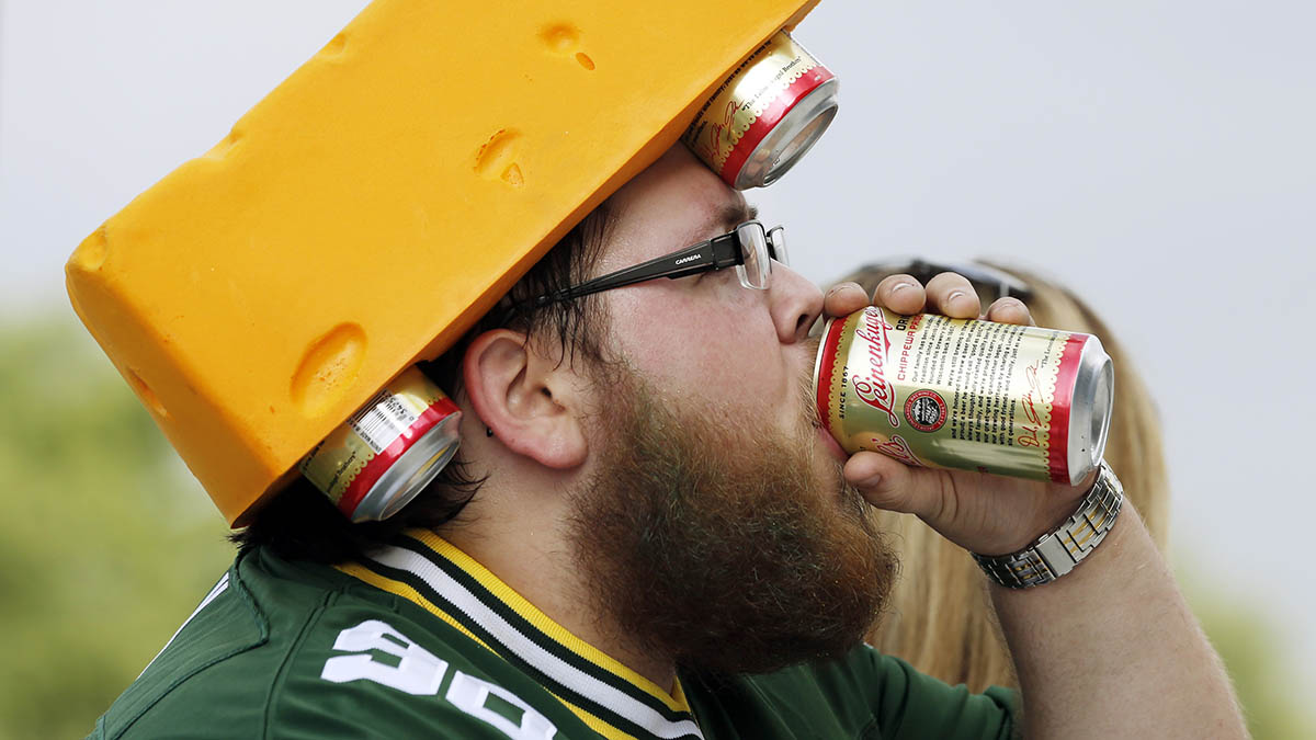 A Green Bay Packers fan drinks a beer before an NFL preseason football game against the Oakland Raiders Friday, Aug. 22, 2014, in Green Bay, Wis.