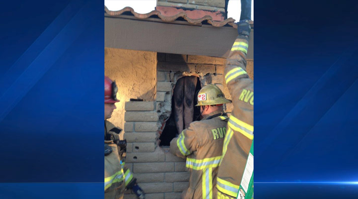 Firefighters rescued a female stuck in a fireplace in Woodcrest, Riverside County, on Saturday, Jan. 3, 2015.