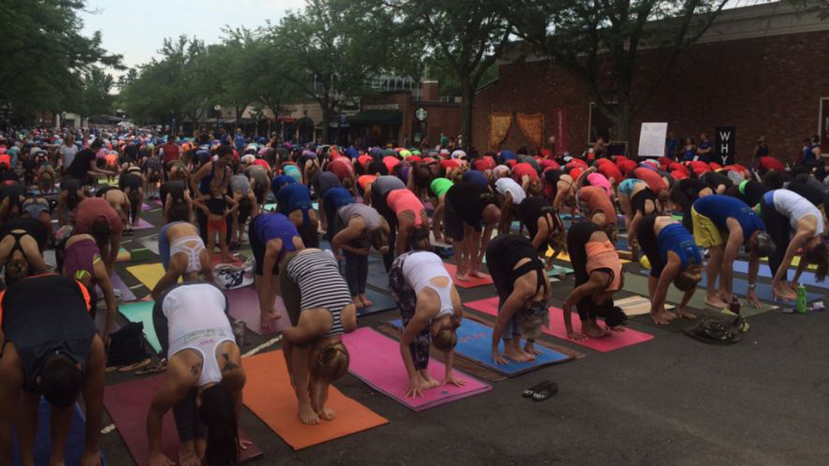 Over 2,000 people came out to participate in a massive outdoor yoga class known as