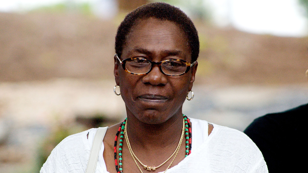 Afeni Shakur-Davis, mother of Tupac Shakur, watches an African drum ceremony in Stone Mountain, Georgia in this September 9, 2006 file photo.